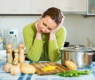 Female needs to make dinner Stock Photos