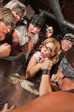 Female Nerd Arm Wrestling with Biker Royalty Free Stock Images