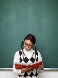 Female nerd reading book Stock Photo