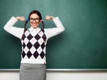 Female nerd showing her muscles Royalty Free Stock Photography