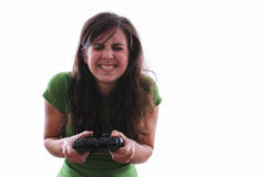 Female nervous playing a console game. Caucasian female holding a game console controller is nervous Royalty Free Stock Photos