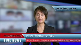 Female news anchor in studio. Asian American female news anchor in studio with background screens and lower thirds, TV news concept stock video footage