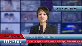 Female news anchor in studio. Asian American female news anchor in studio with background screens and lower thirds, TV news concept stock video