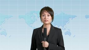 Female news anchor in studio. Asian American female news anchor in studio with map background, TV news concept stock footage