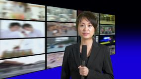 Female news anchor in studio stock video footage