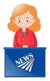Female news reporter at desk Stock Image
