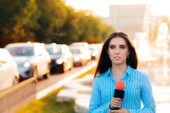 Female News Reporter on Field in Traffic Stock Images