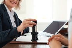 Female notary working with client