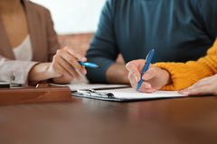 Female notary working with mature couple, closeup