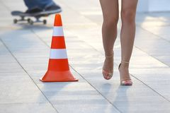 Female nude legs next to a reflective standing sign. The female nude legs next to a reflective standing sign royalty free stock photos