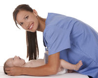 Female nurse with baby Royalty Free Stock Photos