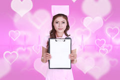 Female nurse with blank clipboard Royalty Free Stock Images