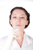 Female nurse checking empty syringe Stock Image