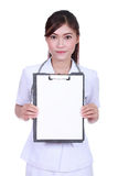 Female nurse with clipboard blank fortext Stock Images
