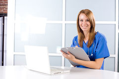 Female nurse at a desk Royalty Free Stock Photography