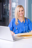 Female nurse at a desk Royalty Free Stock Image