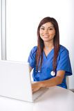 Female nurse at a desk Stock Photography