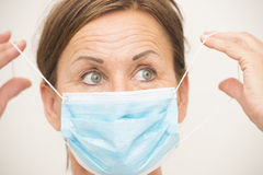 Female nurse or doctor with mask over face Stock Photography