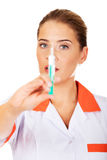Female nurse or doctor with a syringe in hand Royalty Free Stock Image