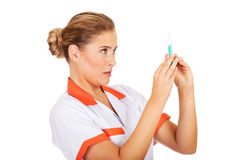 Female nurse or doctor with a syringe in hand Stock Image