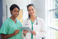 Female nurse and doctor with tablet computer Royalty Free Stock Photography