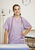 Female nurse in doctors office Royalty Free Stock Image