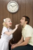 Female nurse examinating man's mouth. Royalty Free Stock Photos