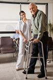 Female Nurse Helping Senior Patient With Walker Royalty Free Stock Images