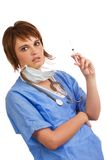 Female nurse holding a filled syringe Royalty Free Stock Photography