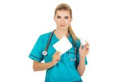 Female nurse holding gauze and hydrogen peroxide Stock Photo