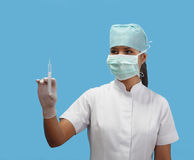 Female nurse holding a syringe Royalty Free Stock Images
