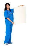 Female nurse holding a white card Stock Image