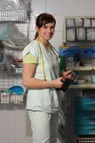 Female nurse in ICU in green uniform with defibrillator Royalty Free Stock Images