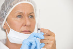 Female nurse with injection vaccination Royalty Free Stock Photography