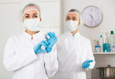 Female nurse and male doctor Stock Photos