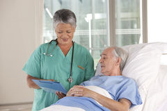 Female nurse and patient Royalty Free Stock Image