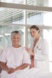Female nurse performing checkup Stock Image