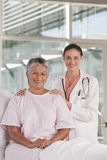 Female nurse performing checkup Royalty Free Stock Images