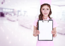 Female nurse show blank clipboard in hospital Stock Photography