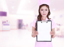 Female nurse show blank clipboard in hospital Royalty Free Stock Photography