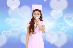 Female nurse with stethoscope Royalty Free Stock Image