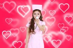 Female nurse with stethoscope Royalty Free Stock Photos
