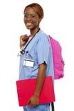 Female nurse under training Stock Images