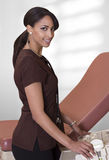 Female nurse using ultrasound machine. Beautiful young female nurse poses with an ultrasound machine Royalty Free Stock Photo