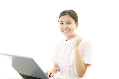 The female nurse who poses happily Royalty Free Stock Photo