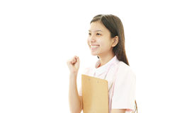 The female nurse who poses happily Royalty Free Stock Image