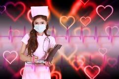 Female nurse writting clipboard Royalty Free Stock Images