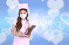 Female nurse writting clipboard Stock Images