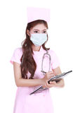 Female nurse writting medical report Royalty Free Stock Images