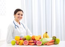Female nutritionist with different fruits and vegetables royalty free stock images